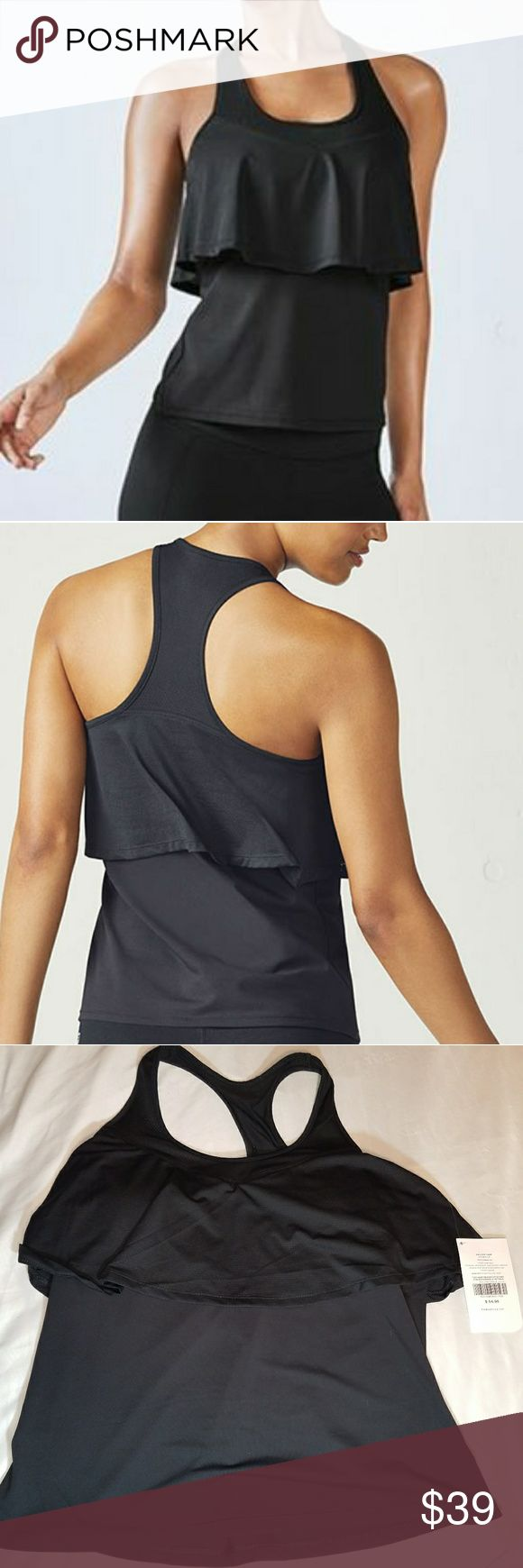 L Fabletics Ashlynn Performance Tank in Black This might be my favorite Fabletics Tank they've ever put out. It looks feminine and delicate, but the mesh outer layer and moisture wicking inner layer means business. It also features a shelf bra with removable cups, so you can decide how much or how little support you need, depending on if you're doing HIIT, yoga, or just hanging around. True Athleisure perfection. Fabletics Tops Tank Tops