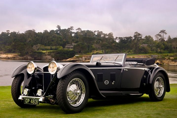 1931 Daimler Double Six 50 Sport Corsica Drophead Coupe: So wide and low it seems to be digging itself into the ground. The hood is 3 miles long and it starts at the front axle centerline. It has the regal stance of a king. A king that could kick ass.