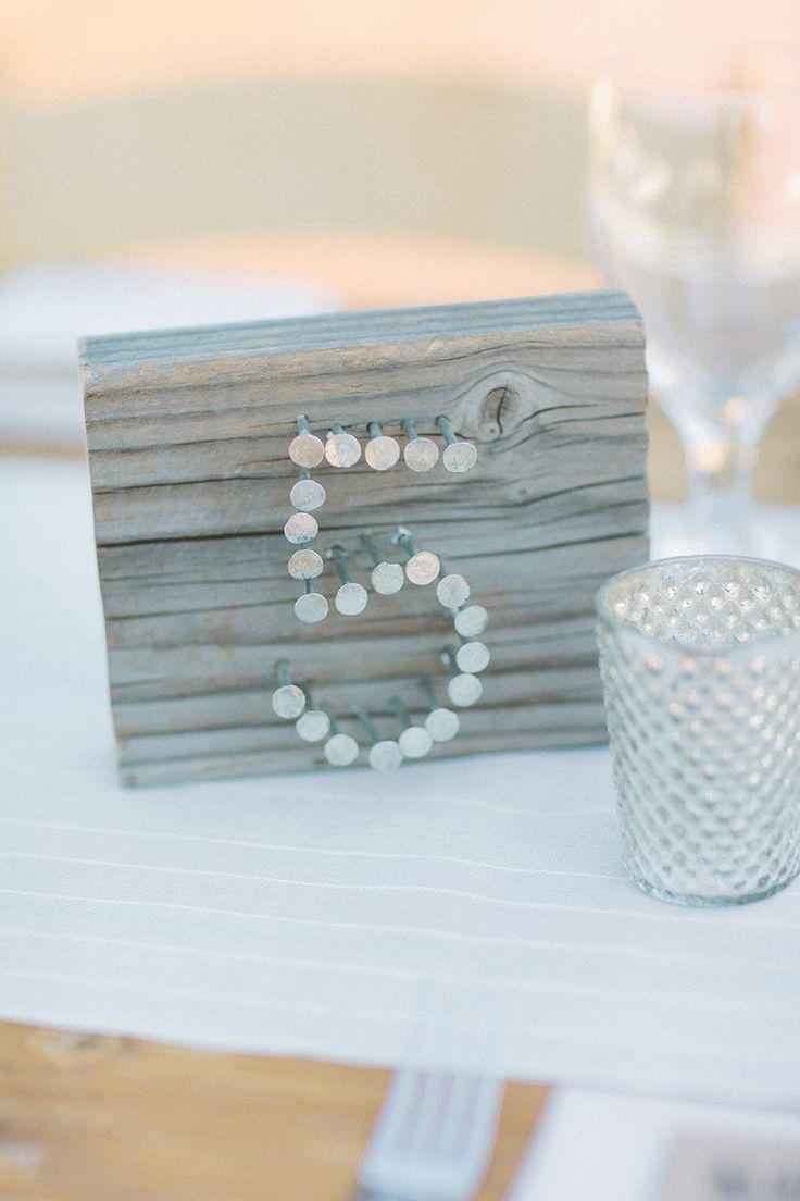 Such a cute idea for a rustic barn wedding! #tablenumbers #weddingideas {We Heart Photography}