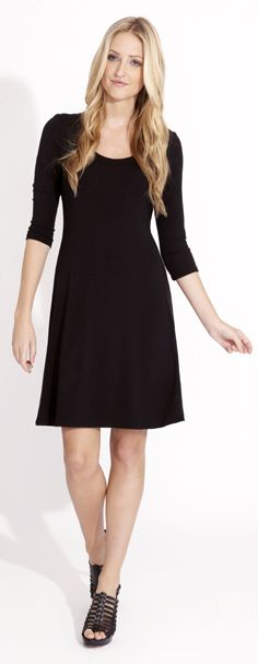 This basic black a-line dress is a must-have staple in every woman's wardrobe. The easy pull-on silhouette flows away from the body, hiding flaws, while the basic crew neckline covers the front in streamlined sophistication. Dress it up or down with pumps and fun jewelry or basic tights and booties for an easy, effortless look.