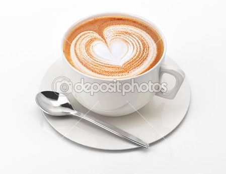 Cappuccino mug close up, with a heart decorated on top of foam. — Stock Image #25717699
