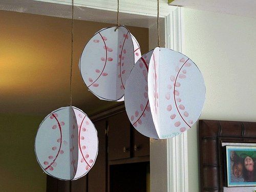 Scissors, glue, a red ink pad, ribbon and a hole punch is all you need to create this hanging baseball craft. Follow @Laura Kelley for instructions on how to make these adorable baseballs.