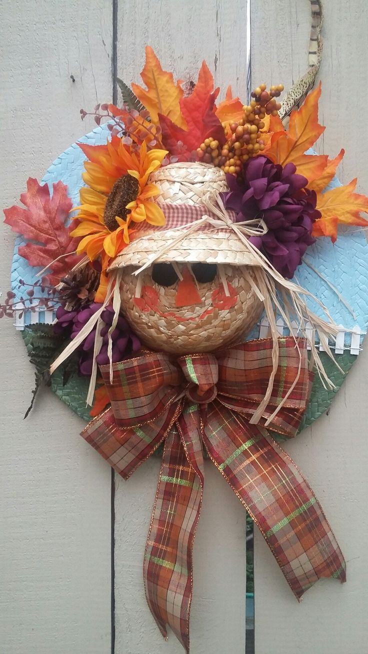 Fall wreath, scarecrow, sunflower, straw hat.