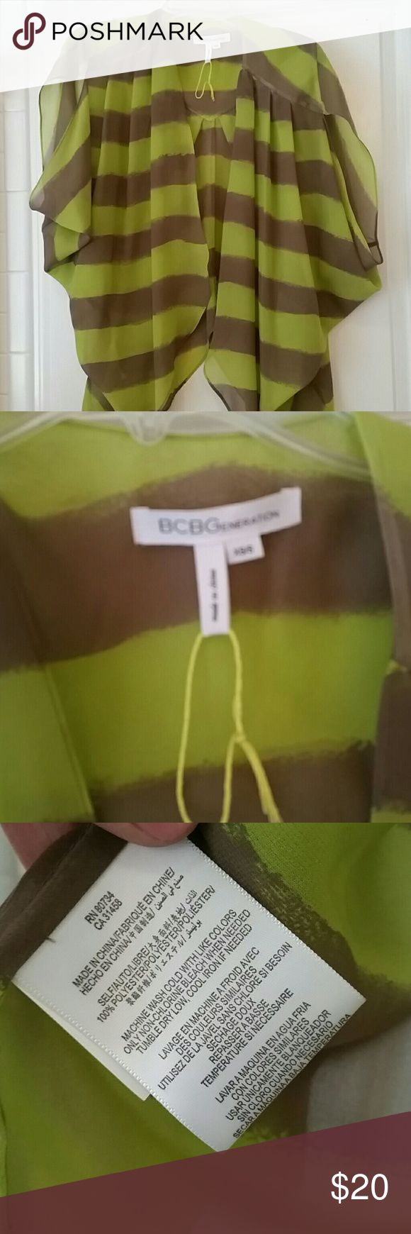 BCBGeneration Top Loose fitting gorgeous top. Worn once, excellent coition no tears no stains. BCBGeneration Tops