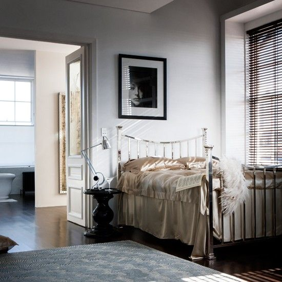 A decadent affair ~ Chrome bed, satin sheets and neutral tones ~ classic vintage glamour...