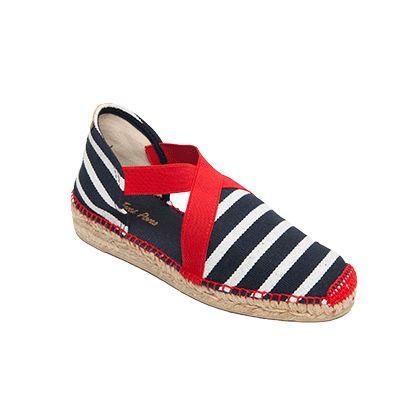 ESTARTIT de Toni Pons es un modelo de alpargata extremadamente cómodo. Las tiras de goma cosidas a la tela otorgan una sujeción del pie excepcional. Las telas rayadas en diferentes colores dan alegría y un toque de diversión al calzado. Otro súperclásico de Toni Pons.