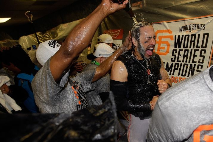 KANSAS CITY, MO - OCTOBER 29: Michael Morse #38 of the San Francisco Giants celebrates with teammates in the locker room after defeating the Kansas City Royals 3-2 to win Game Seven of the 2014 World Series at Kauffman Stadium on October 29, 2014 in Kansas City, Missouri. (Photo by Ezra Shaw/Getty Images)
