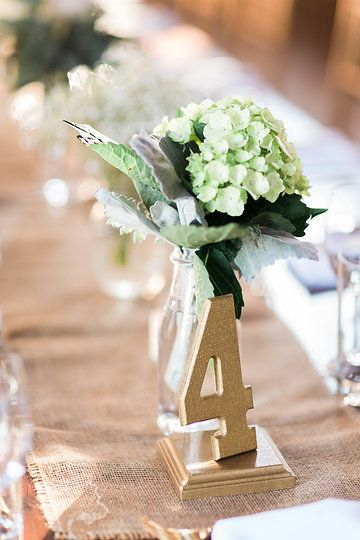 Gold Table Numbers, Burlap Table Runner, Milk Bottle Center Pieces. Photo from Jess & Francis collection by 1486 Photography