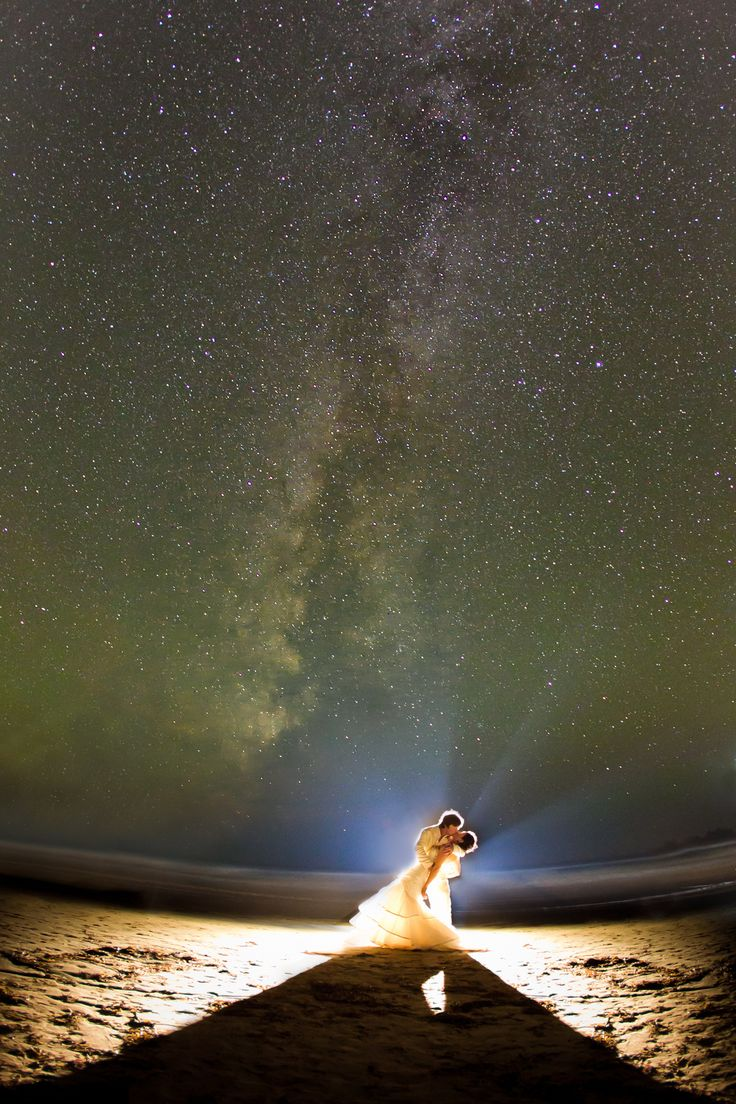 How gorgeous is this photo of a bride and groom under the starry night sky in Tofino?!