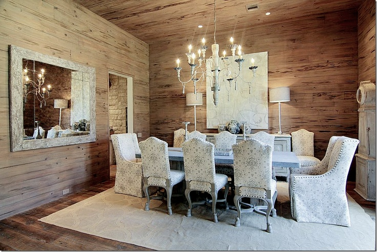 Reclaimed wood on walls in this elegant dining room