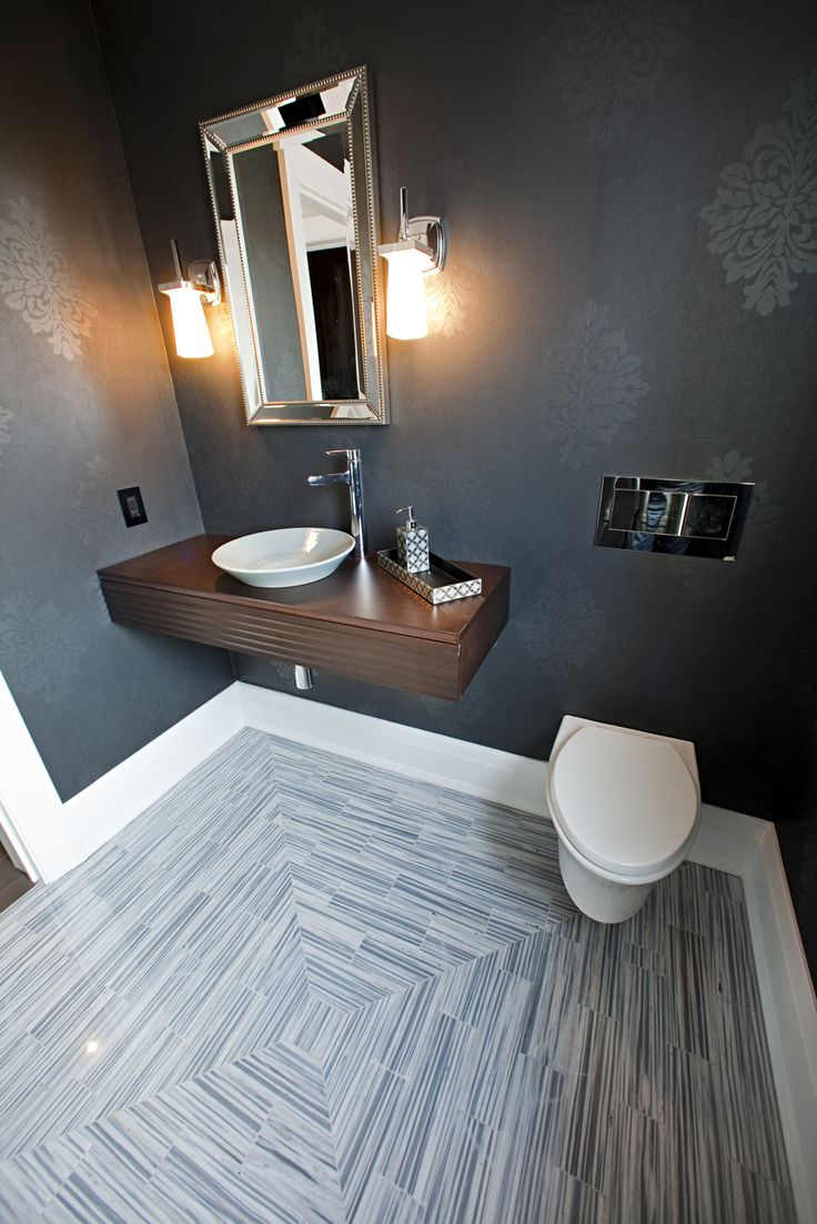 Here, we brought to the forefront older influences with modern flair in the form of wallpaper choices, a floating vanity and perfectly laid tile that continues to drops jaws.