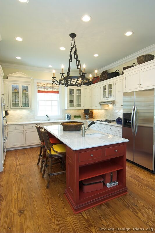 Traditional White Kitchen Cabinets  (Kitchen-Design-Ideas.org)  - like the shelves / drawers in the end towards entry door