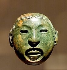 Aztec jade mask from the 14th century depicting the god Xipe Totec.