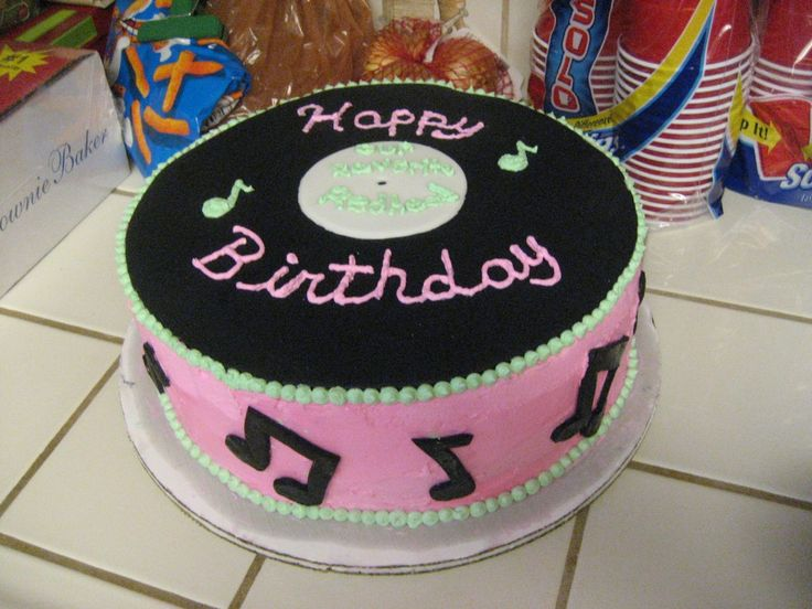 Record Cake - I made this cake for my neices 11th birthday. She had a sock hop theme and wanted a record cake.  Record and music notes are made of fondant. 12''  2 Layer white cake with strawberry banana filling.