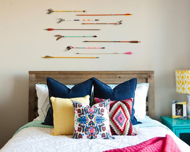 colorful tribal eclectic teen girl bedroom with arrows and navy hot pink turquoise and yellow