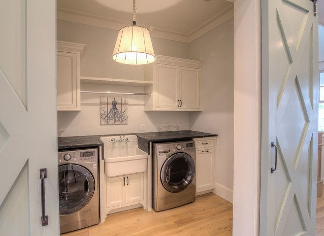 Second floor laundry room with sliding barn doors. Notice the sink and custom cabinets. Counters are soapstone.