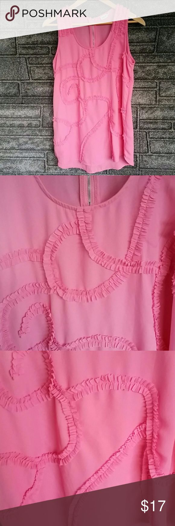 Charming Charlie hot pink blouse medium NWOT Charming Charlie sleeveless blouse features a crew neck with ruffle pattern throughout. Blouse has never been worn. Perfect with a pair of slacks! Measures approximately 30 inches from top to bottom, 15 inches armpit to armpit. 100% polyester. Charming Charlie Tops Blouses