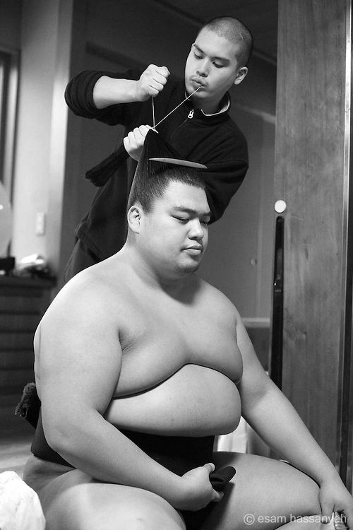 Takami Sato has his hair prepared by a tokoyama - a hairdresser employed by the Japan Sumo Association to cut and prepare sumo wrestlers hair. CCOPYRIGHT:esam hassanyeh