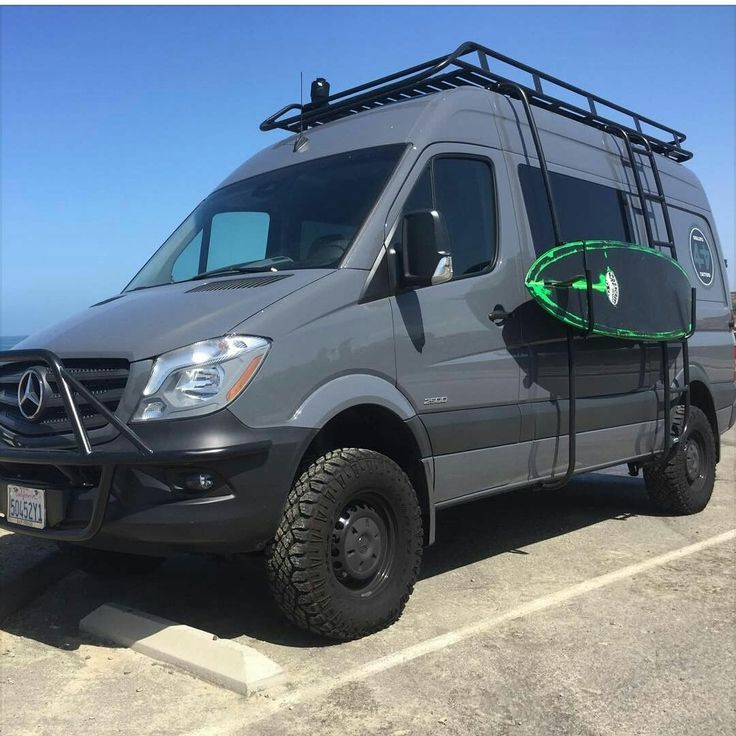 Sprinter with Aluminess front light bar, roof rack, ladder and surf pole.  Getting ready to go ride the waves!