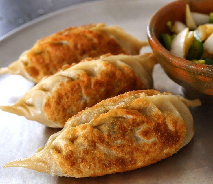 Kimchi Dumplings = beef/pork, ginger, garlic, soy sauce, sugar, sesame oil, pepper, potato starch noodles, onion, green onions, kimchi, firm tofu, salt, vegetable oil, mandu wrappers.