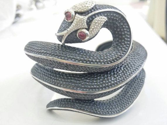 Check out this item in my Etsy shop https://www.etsy.com/uk/listing/492631310/snake-cuff-bracelet-in-silver-with