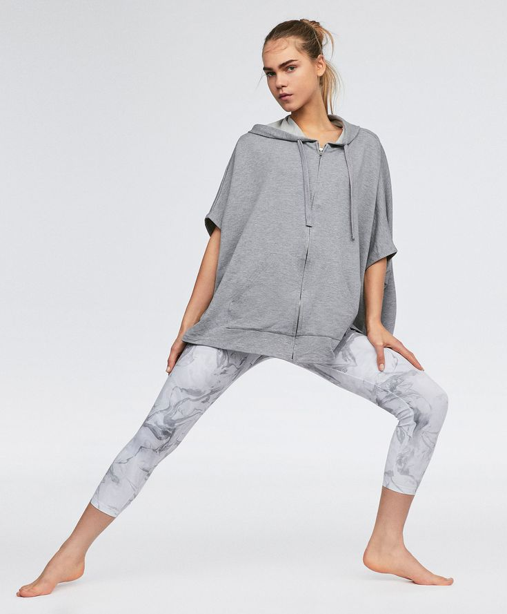 Short sleeve poncho, 39.99£ - Short sleeve poncho perfect for practising yoga. - Find more trends in women fashion at Oysho .