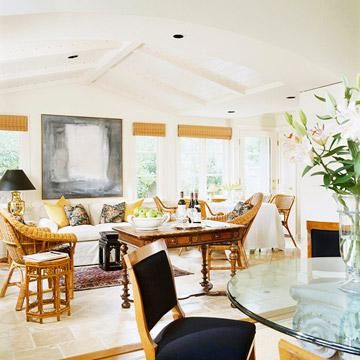 This large room accommodates a variety of family interests. Two tables-in addition to the dining table-can be used for entertaining, games, puzzles, paying bills or other activities. Lightweight wicker chairs and small cube tables can be easily moved from one area to another