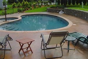 pool deck furniture ideas | ... Stamped and Integrally Colored Pool Deck Blends with Rhode Island Home