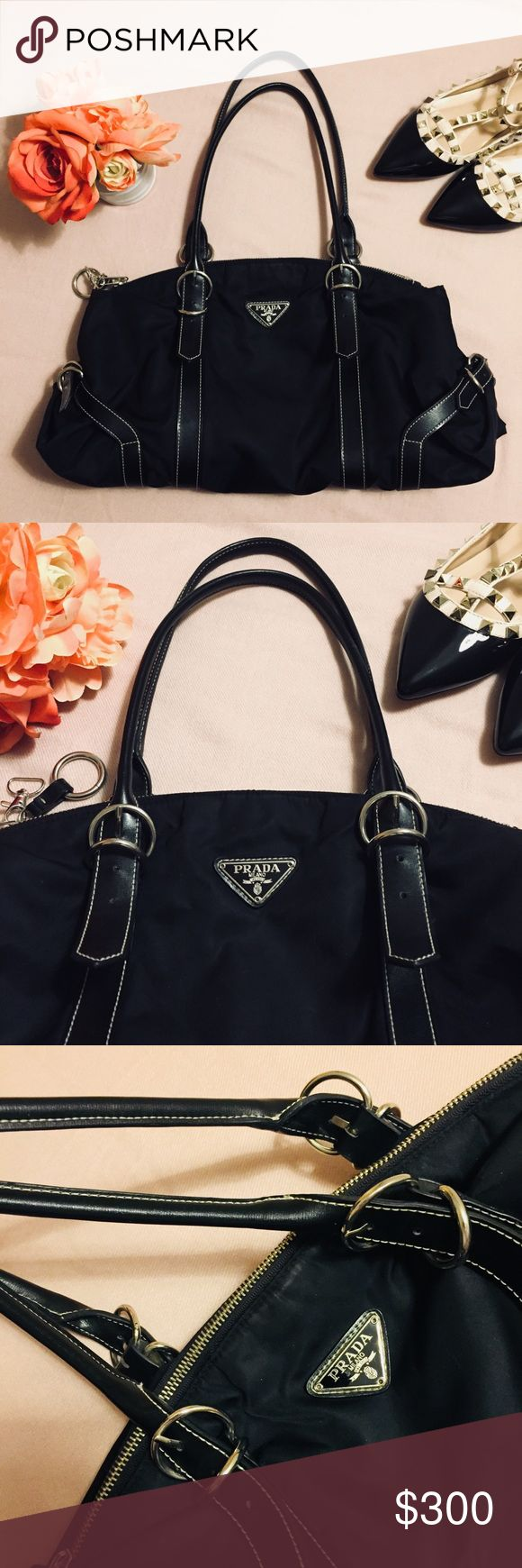 🚫SOLD via PPal🚫 AUTH PRADA TESSUTO NERO Prada Tessuto (Nylon) in Nero (Black). Silver hardware. Leather and body of the bag are in excellent condition. Interior and exterior are clean. No tears, cracks on leather, scuffs, rips or stains. 😍   Lost its authenticity card and it's original dustbag. I have a Prada dustbag for my other purse. A bit small for this but I can include it just let me know.❤️ Prada Bags Shoulder Bags