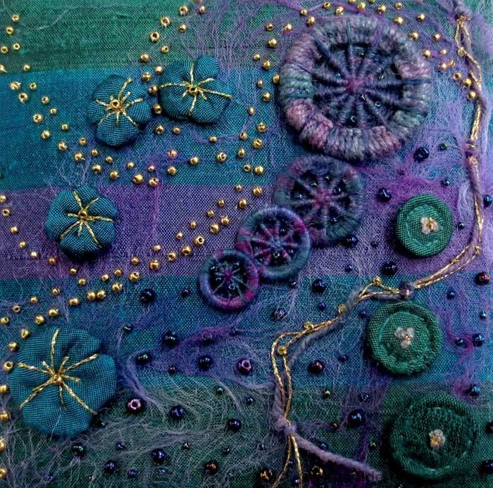 Lesley Watt - tutorial for making Dorset buttons.  This is an example of the buttons on a piece of fiber art.  Contemporary embroidered box lid detail - Stitched and designed by R Duncan