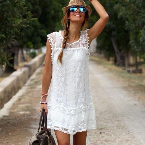 Moda para el verano 2017 atractivo ocasional de las mujeres sin mangas de la playa vestido blanco sólido borla corta mini vestido de encaje Vestidos Tamaño más