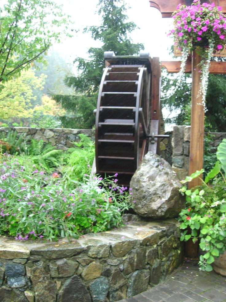 Elegant Working Water Wheel At The Rose Garden