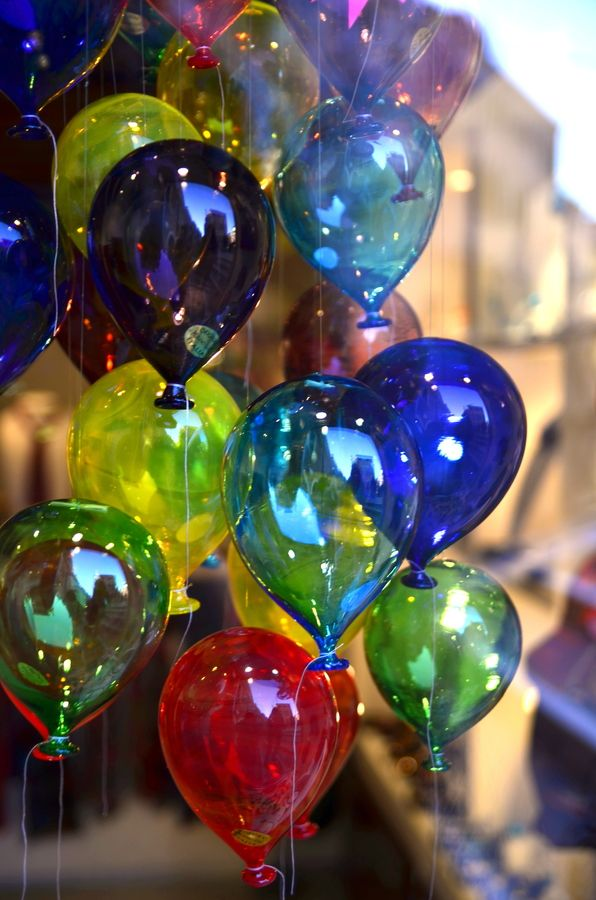 Glass Balloons...oh my goodness...I want some...I can just imagine how cheery and beautiful these would look if they were placed next to a sunny window.