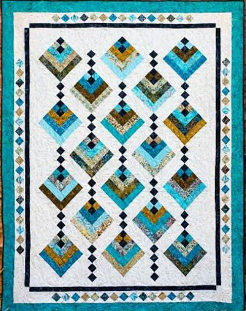 "This quilt was designed for 2 1/2"" Strips. What a perfect name for this elegant quilt. The little four patch between the blocks gives the effect of hanging blooms. And the piecework in the border adds"