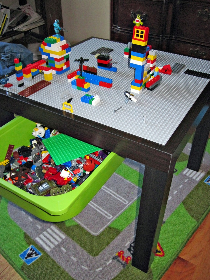 IKEA Lack side table converted to a Lego table with Lego storage. Boys LOVE it. Idea from IKEA Hackers.