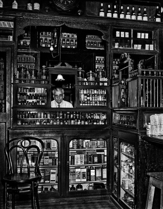 Ara Guler TURKEY. 1958. Pharmacist and old-fashioned pharmacy at Tepebasi.