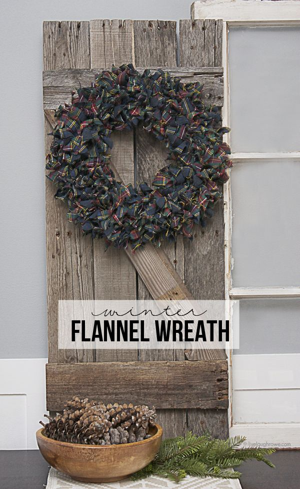 A super easy Winter Flannel Wreath using strips of plaid flannel fabric to create a sense of warmth and add some pops of color! www.livelaughrowe.com