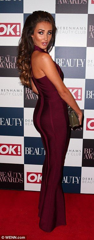 Slick and sexy: TOWIE star Megan McKenna sported a wine hued number with a teardrop shaped...