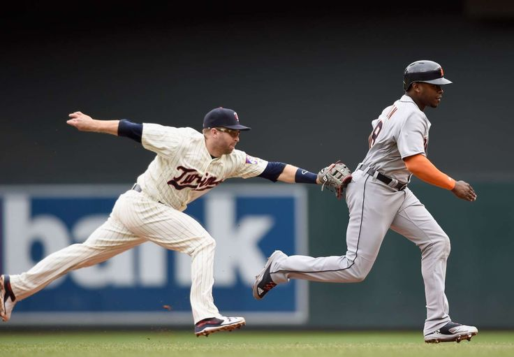 Caught off base Brian Dozier of the Minnesota Twins tags out Justin Upton of the Detroit Tigers during the fourth inning of game one of a doubleheader on September 22, 2016 at Target Field in Minneapolis. Detroit won 9-2.