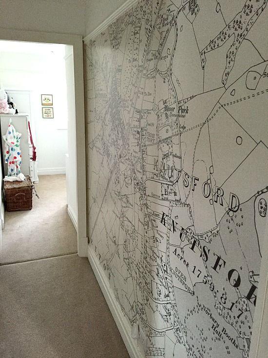 Narrow hallway with map wallpaper