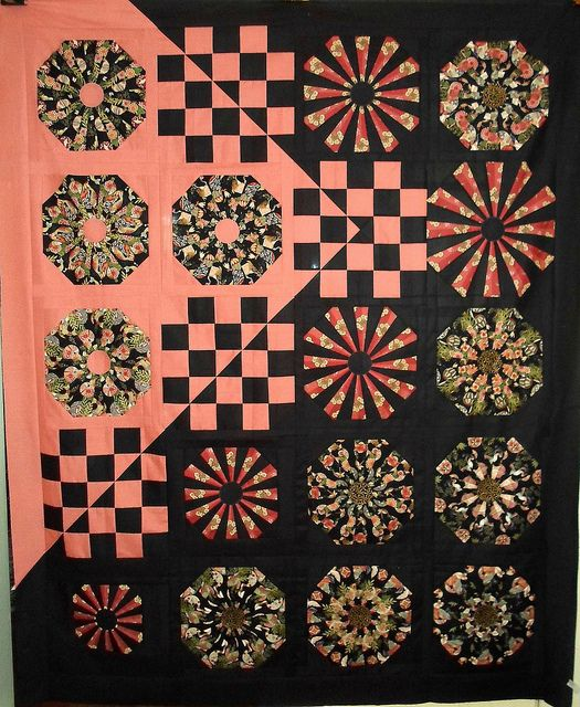 This woman is seriously talented in designing original quilt settings!   Asian Medley by Linda Rotz Miller