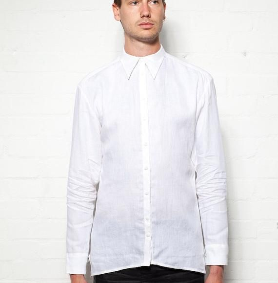 This is a 100% Linen shirt, with the classic stylings from Tom Hayden. This lightweight garment is a perfect solution for smart summer occasions of just for light casual wear. It features a pointed collar leading into a thin button placket. The curver front and back hem are joined by a slanted seam at the side. The back yoke is also curved. The cuff placket is extended to make rolling up the sleeves more easy and extra comfortable.This Shirt is Handmade by Tom Hayden