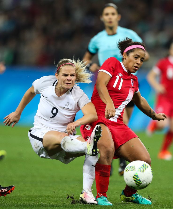 Eugenie le Sommer (L) of France and Desiree Scott of Canada in action during the match between Canada and France womens football quarter final for the Olympic Games Rio 2016 at Arena Corinthians on August 12, 2016 in Sao Paulo, Brazil.