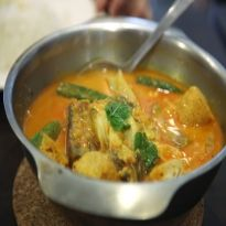 Papad Ki Sabzi: Fried papad pieces in a gravy of curd and spices.