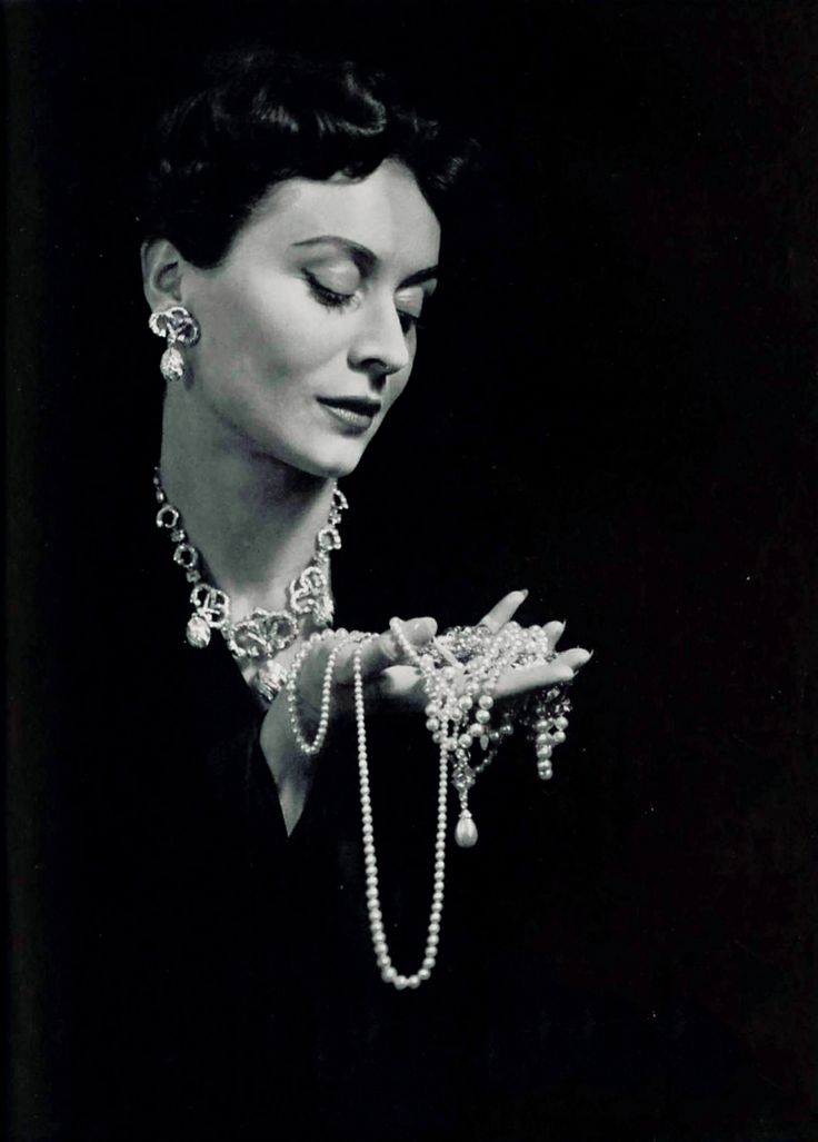 Model in jewelry ad (Bijoux Burma) photographed by Cecil Beaton, 1952