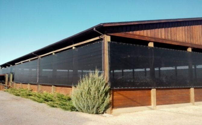 Outdoor Ventilated Screen Material on Horse Arena