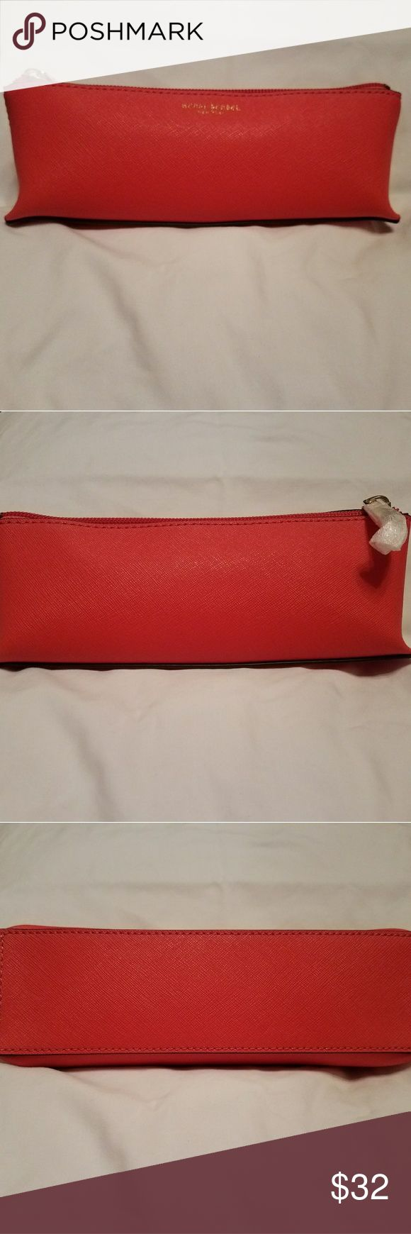 """Henri Bendel Orange West 57th Small Cosmetic Bag New With Tags.  Henri Bendel - Orange West 57th  Small Cosmetic Bag.  Saffiano leather with gold brass accent. Triangular shape 1"""" at top and 3"""" at bottom.  8"""" long.  Fits great in the Crossbody Tote in My Closet.   Very cute cosmetic bag.  Dust cover bag included.  Smoke-free and pet-free home. Henri Bendel Bags Cosmetic Bags & Cases"""