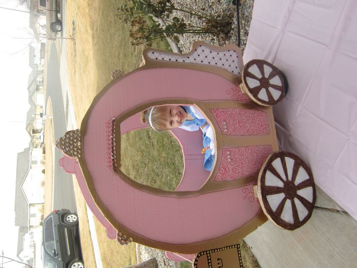 Princess carriage made out of insulation board and dowells sitting on top of a Radio Flyer.