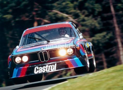 1974. Nurburgring 6 Hours. Hans-Joachim Stuck (Hans-Joachim Stuck (D)Ronnie Peterson (S)) jumping with the BMW 3.0 CSL.