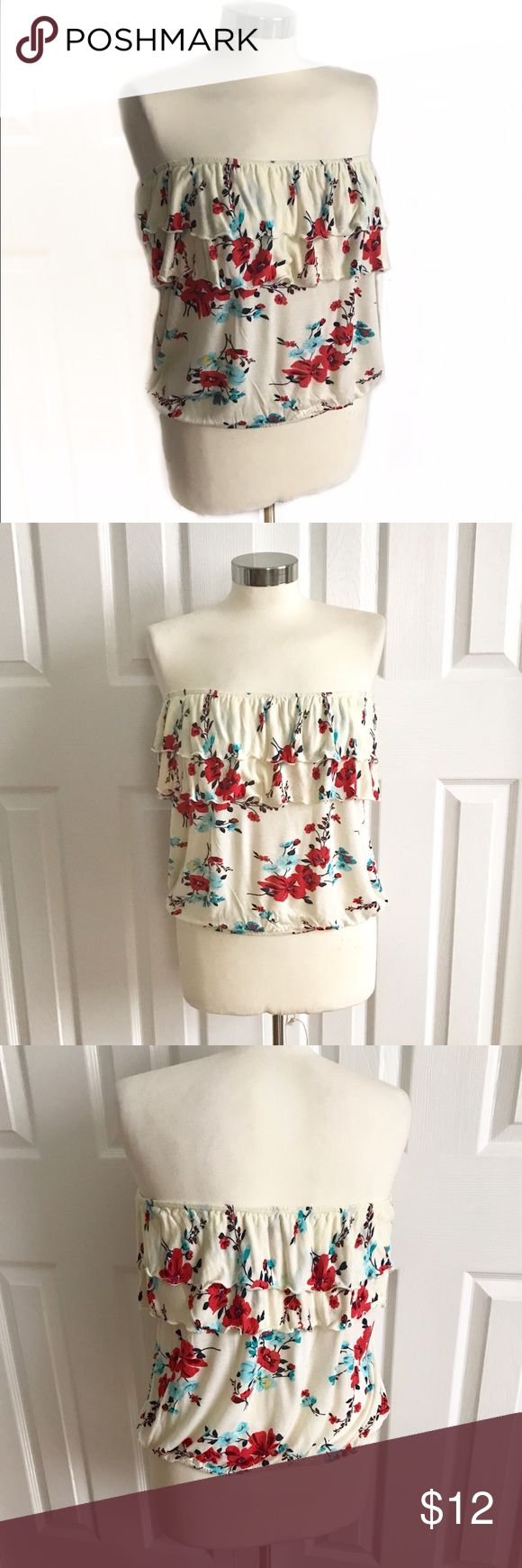 Full Tillt Strapless Cream Floral Shirt Strapless bandeau top with ruffle accent on top, off-white cream with red blue and some yellow floral design. Full Tilt size medium. Full Tilt Tops